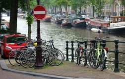 Amsterdam, The Netherlands, city canals, boats, bridges and streets. Unique beautiful and wild European city. Red light district, erotic city. Bicycles vintage Stock Photos