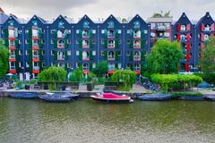 08-07-2019 amsterdam the netherlands shot of authentic amsterdam buildings next to the channel royalty free stock photo