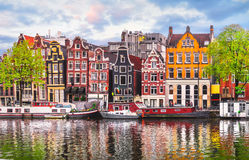 Amsterdam Netherlands dancing houses over river Amstel. Landmark in old european city spring landscape