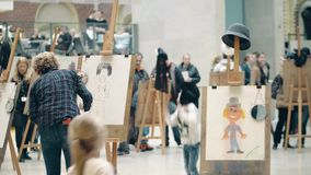 AMSTERDAM, THE NETHERLANDS - DECEMBER 26, 2017. Amateur portrait drawing contest for kids and adults. AMSTERDAM, THE NETHERLANDS - DECEMBER 26, 2017 Amateur stock footage