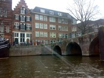 AMSTERDAM, NETHERLANDS - DECEMBER 25, 2007: Architecture and people on the streets city. AMSTERDAM, NETHERLANDS - DECEMBER 25, 2007: Architecture and people on stock image
