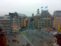 AMSTERDAM, NETHERLANDS - DECEMBER 25, 2007: Architecture and people on the streets city. AMSTERDAM, NETHERLANDS - DECEMBER 25, 2007: Architecture and people on stock photo