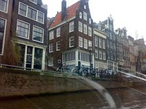 AMSTERDAM, NETHERLANDS - DECEMBER 25, 2007: Architecture and people on the streets city. AMSTERDAM, NETHERLANDS - DECEMBER 25, 2007: Architecture and people on stock images