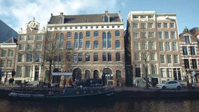 Amsterdam, Netherlands - December 26, 2017. City canal embankment and moored boat casino. Amsterdam, Netherlands - December 26 2017 City canal stock video footage
