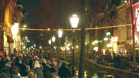 AMSTERDAM, NETHERLANDS - DECEMBER 27, 2017. Crowded embankment of the famous red light district De Wallen. AMSTERDAM, NETHERLANDS - DECEMBER 27, 2017. Crowded stock video