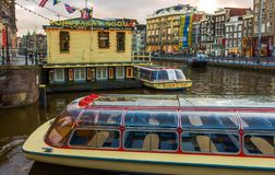 Amsterdam, Netherlands - December 14, 2017: The cruise boat in Canal of Amsterdam Royalty Free Stock Photos