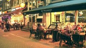 AMSTERDAM, THE NETHERLANDS - DECEMBER 25, 2017. Dutch kitchen restaurant veranda at night. AMSTERDAM, THE NETHERLANDS - DECEMBER 25, 2017 Dutch kitchen stock video footage
