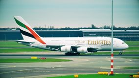 AMSTERDAM, NETHERLANDS - DECEMBER 25, 2017. Emirates Airbus A380 airliner taxiing at the Schiphol international airport. AMSTERDAM, NETHERLANDS - DECEMBER 25 stock video