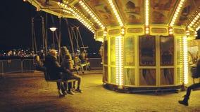 AMSTERDAM, NETHERLANDS - DECEMBER 26, 2017. Illuminated retro carousel at night. AMSTERDAM, NETHERLANDS - DECEMBER 26 2017 Illuminated retro carousel stock video footage