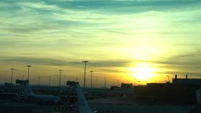 4K Sunset view of Airplane wait at Amsterdam Schiphol international airport stock footage