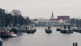 AMSTERDAM, NETHERLANDS - DECEMBER 26, 2017. Nationale Opera en Ballet building on the Amstel river embankment. AMSTERDAM, NETHERLANDS - DECEMBER 26, 2017 stock video