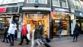 Amsterdam, Netherlands, December 2018. People bwalking on the street. December 2018 stock video