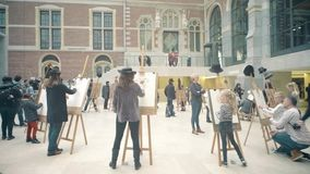 AMSTERDAM, NETHERLANDS - DECEMBER 26, 2017. Portrait drawing contest for kids and adults. AMSTERDAM, THE NETHERLANDS - DECEMBER 26, 2017 Amateur drawing contest stock photos