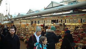 AMSTERDAM, NETHERLANDS - DECEMBER 26, 2017. POV shot of crowded flower and souvenir marketplace. AMSTERDAM, NETHERLANDS - DECEMBER 26, 2017. POV shot of crowded stock footage