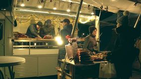 AMSTERDAM, NETHERLANDS - DECEMBER 28, 2017. Traditional sausage vendors` stall in the evening. AMSTERDAM, NETHERLANDS - DECEMBER 28 2017 Sausage vendors stock video