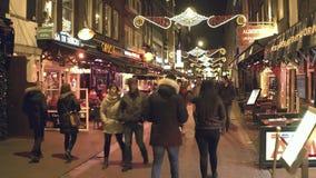 AMSTERDAM, NETHERLANDS - DECEMBER 25, 2017. Tourist place full of street restaurants on Christmas eve. AMSTERDAM, NETHERLANDS - DECEMBER 25, 2017 Street stock footage