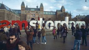 AMSTERDAM, NETHERLANDS - DECEMBER 26, 2017. Tourists near I amsterdam sign near the Rijksmuseum, the Dutch national