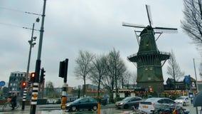 AMSTERDAM, NETHERLANDS - DECEMBER 29, 2017. Traditional windmill in the city. AMSTERDAM, NETHERLANDS - DECEMBER 29 2017 Traditional windmill stock footage