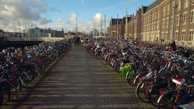 AMSTERDAM, THE NETHERLANDS - DECEMBER 26, 2017. Walk along big bicycle parking in the city