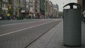 AMSTERDAM, NETHERLANDS -dustbin on street with the emblem of the city - triple x stock footage
