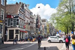 Colorful houses on the Amstel street in the city center of Amsterdam. Amsterdam, Netherlands, Europe - July 27, 2017. Colorful houses on the Amstel street in Royalty Free Stock Image