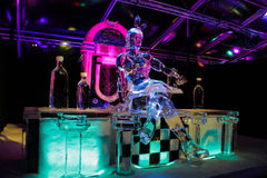 Amsterdam, Netherlands, February 4, 2017 - Amsterdam Ice Festival. Woman made of ice sitting at the bar Stock Photos