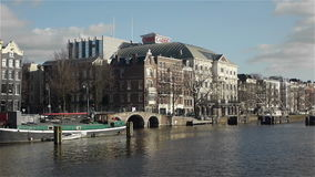 AMSTERDAM, THE  NETHERLANDS - February 27, 2015: Carre theater and canal in Amsterdam. Carre theater in Amsterdam, the Netherlands. A famous and historic theater stock footage