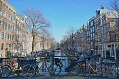 AMSTERDAM, NETHERLANDS - FEBRUARY 23, 2019: Crooked and colorful heritage buildings, located along Bloemgracht Canal royalty free stock photos