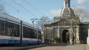 AMSTERDAM, THE  NETHERLANDS - February 27, 2015: Traffic in Amsterdam. Traffic in Amsterdam, the Netherlands. Trams, cars, people and bicycles are passing by stock footage