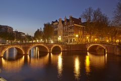 Amsterdam, Netherlands - Houses at a canal in the blue hour Stock Photo