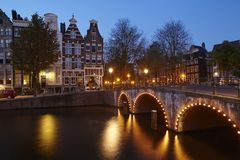 Amsterdam, Netherlands - Houses at a canal in the blue hour Royalty Free Stock Photography
