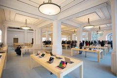 AMSTERDAM, NETHERLANDS. Interior View of Apple Store in Amsterdam. AMSTERDAM, NETHERLANDS - November 6, 2017: Interior View of Apple Store in Amsterdam royalty free stock photography