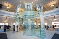 AMSTERDAM, NETHERLANDS. Interior View with Glass Stairs in Apple Store. AMSTERDAM, NETHERLANDS - November 6, 2017: Interior View with Glass Stairs in Apple Royalty Free Stock Photos