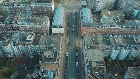 AMSTERDAM, NETHERLANDS - JANUARY 1, 2018. Aerial view of city street, apartment buildings and inner courtyards. AMSTERDAM, NETHERLANDS - JANUARY 1, 2018 Aerial Royalty Free Stock Images