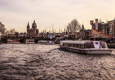 AMSTERDAM, NETHERLANDS - JANUARY 30, 2015: Beautiful views of streets, ancient buildings, boat, embankments of Amsterdam - also ca Royalty Free Stock Image
