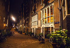 AMSTERDAM, NETHERLANDS - JANUARY 22 2016: City streets of Amsterdam at night. General views of city landscape on January 22, 2016. In Amsterdam - Netherland stock photography