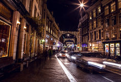 AMSTERDAM, NETHERLANDS - JANUARY 22 2016: City streets of Amsterdam at night. General views of city landscape on January 22, 2016. In Amsterdam - Netherland stock image