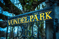 AMSTERDAM, NETHERLANDS - JANUARY 1, 2016: Entrance of Vondel park in Amsterdam, letters on fence. Amsterdam - Netherland. Royalty Free Stock Image