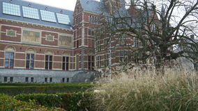AMSTERDAM, THE NETHERLANDS - JANUARY 22, 2015: Exterior and garden of the Rijksmuseum. The exterior of the Rijksmuseum and the garden at Museumplein in Amsterdam stock video footage