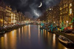 AMSTERDAM, NETHERLANDS - JANUARY 4 2016: Amsterdam light festival. In the canals from Amsterdam in the Netherlands on the 4th of january 2016 Stock Photos