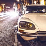 AMSTERDAM, NETHERLANDS - JANUARY 5, 2016: Vintage white car parked in center of Amsterdam at night time. January 5, 2016 in Amster. Dam - Netherland Stock Photography