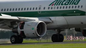 Airbus A319 landing. AMSTERDAM, THE NETHERLANDS - JULY 26, 2017: Alitalia Airbus A319 braking after landing landing on runway 18R Polderbaan. Shiphol Airport stock footage