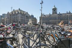 Bicycle parking in the central Dam Square in Amsterdam. Amsterdam, Netherlands - July 02, 2018: Bicycle parking in the central Dam Square in Amsterdam stock images