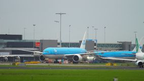 Traffic at Amsterdam airport. AMSTERDAM, THE NETHERLANDS - JULY 25, 2017: Boeing 777 Royal Dutch Airlines KLM and Boeing 737 Transavia taxiing on apron, Shiphol stock video
