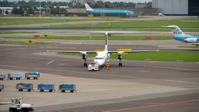 FlyBe Bombardier Dash 8 Q400 towing before departure stock video footage