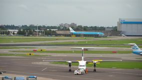 FlyBe Bombardier Dash 8 Q400 towing before departure stock video