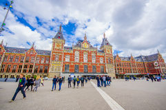 Amsterdam, Netherlands - July 10, 2015: Central station as seen from outside plaza, beautiful traditional European Stock Images
