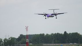 Turboprop airplane landing. AMSTERDAM, THE NETHERLANDS - JULY 27, 2017: FlyBe Bombardier Dash 8 Q400 G-JECG landing. Shiphol Airport, Amsterdam, Holland stock video