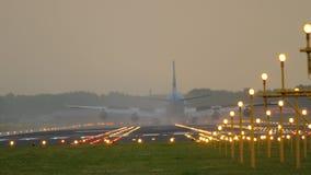 Airplane landing at runway 18R Polderbaan stock video footage