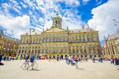 Amsterdam, Netherlands - July 10, 2015: Royal Palace on a beautiful sunny day, majestic European architecture and Royalty Free Stock Photo